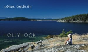 Post card from Hollyhock retreat on Cortes Island, BC Canada. It says 'sublime simplicity' and has a seated figure looking out at a blue ocean.